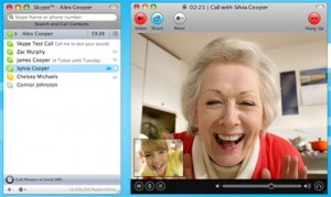 Woman video-chatting with her grand-daughter on Skype.