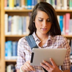 woman-in-library-with-tablet