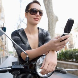 woman-on-scooter-with-mobile